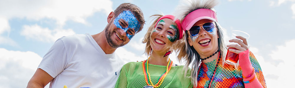Rewind festival 2018 attendees wearing glitter on their faces