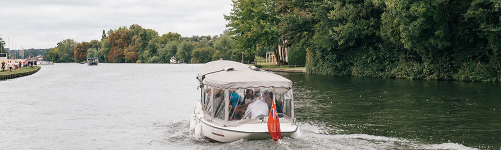 Water taxi heading to Rewind South 2018 on Temple Island Meadows