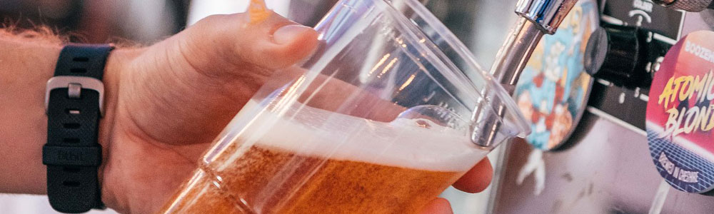 Beer being pulled into a cup at rewind festival 2018